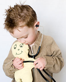 Boy 'listening' to his stuffed animal's heart with a stethoscope
