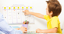 Child pointing at calendar